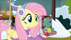 1908303__safe_edit_edited screencap_screencap_sound edit_fluttershy_holly the hearths warmer doll_best gift ever_animated_clothes_female_i love being a.webm